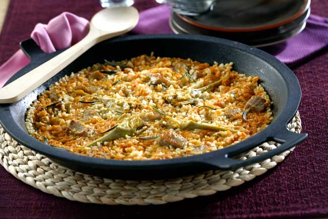 arroz con presa ibérica y alcachofas
