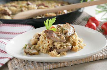 Delicioso arroz con secreto ibérico y boletus